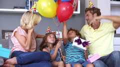 Family celebrating a birthday together - stock footage