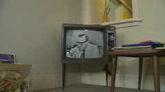 Cronkite Announces the Death of JFK - 1960's archival news on old television Stock Footage