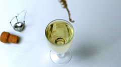 String of pearls dropping in glass of champagne Stock Footage