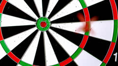 Dart landing a bulls eye Stock Footage
