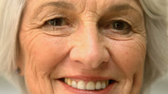 Old cheerful woman smiling Stock Footage