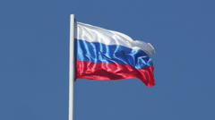State flag of the Russian Federation is flying in the blue sky Stock Footage