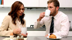 Couple chatting during breakfast before work Stock Footage