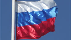 Russian state flag is fluttering in the blue sky Stock Footage