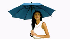 Pretty woman under blue umbrella cowering with fear Stock Footage