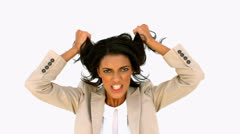 Stressed businesswoman shaking her hair Stock Footage