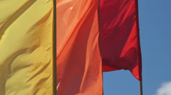 Bright flags are fluttering in the blue sky Stock Footage