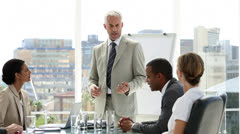 Businessman presenting to his team who applaud him - stock footage
