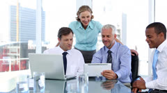 Group of business people using laptop and tablet computer - stock footage