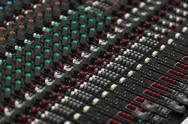Closeup of a concert sound control board. Stock Photos