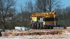 Cranes and workers on the site 2 - stock footage