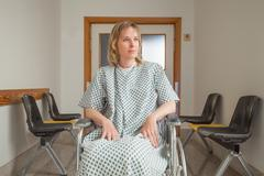 Thoughtful patient sitting on a wheelchair Stock Photos