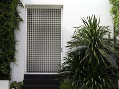 White wall entrance with garden Stock Photos