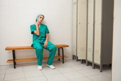 Tired nurse sitting on a bench Stock Photos