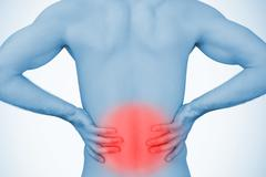 Man holding his back with highlighted red pain Stock Photos