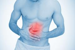 Man with highlighted stomach ache - stock photo