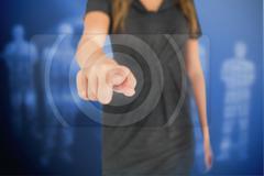 Businesswoman pressing on touchscreen - stock photo