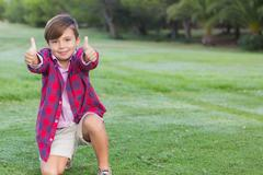 Cute boy giving thumbs up - stock photo