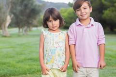 Portrait of cute brother and sister - stock photo
