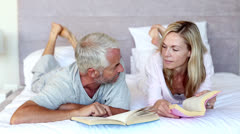 Serious couple talking together in the bed Stock Footage