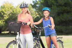 Stock Photo of Portrait of daughter and mother with bikes