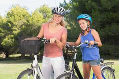 Mother and daughter deciding where to bike - stock photo