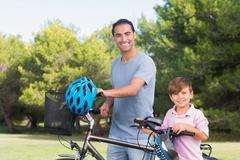 Happy father and son with their bikes Stock Photos