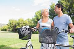 Happy couple ready to go biking Stock Photos