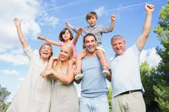 Portrait of cheering multi-generation family - stock photo