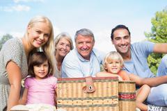 Portrait of happy multi-generation family having a picnic - stock photo