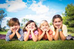 Stock Photo of Portrait of cute children posing in the park