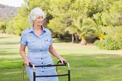 Happy elderly woman with zimmer frame Stock Photos