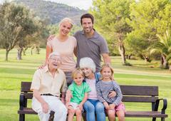 Portrait of multi-generation family in the park - stock photo