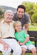 Portrait of three generations of men of family Stock Photos