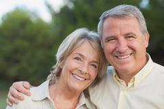 Stock Photo of Loving older couple smiling