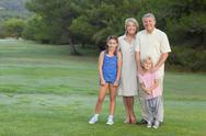 Grandparents standing with their grandchildren Stock Photos