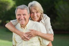 Stock Photo of Man giving his partner a piggy back