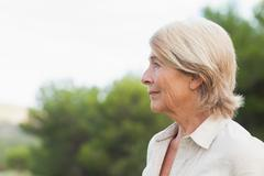 Thoughtful older woman looking into the distance Stock Photos