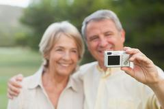 Couple taking a photo of themselves - stock photo