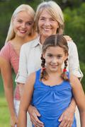 Three generations of women smiling together portrait Stock Photos
