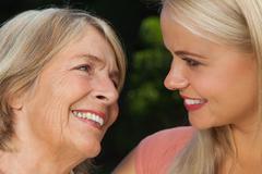 Smiling mother with adult daughter - stock photo