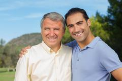 Stock Photo of Father and adult son portrait