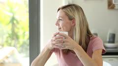 Blonde woman enjoying her drink Stock Footage