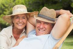 Stock Photo of Older couple relaxing in the garden portrait