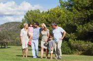Family walking through the park Stock Photos