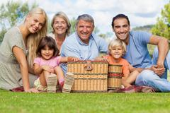Multi-generation family portrait in the park - stock photo