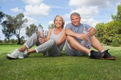 Stock Photo of Portrait of older couple in sportswear with water bottles