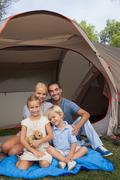Stock Photo of Smiling family on a camping holiday portrait