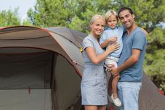 Couple with blonde son on camping holiday Stock Photos