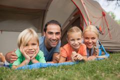 Portrait of happy family on camping holiday - stock photo